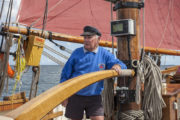 Pilgrim Skipper on the helm